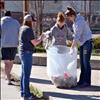 Members of Ronan High School's spring sports teams — including, from left, Ronan High School track and field throwing coach Rod Harris, and athletes Aspen Jore, Alex Dennis and Ashley Peterson — commemorated National Volunteer Week by fanning out and cleaning up garbage around town last week. Ronan Booster Club Secretary Debbie Garcia said she thought it was a good idea for the kids to support the local community, because of the support the town, its people and businesses give to the sports teams. Two truckfulls of waste were collected.