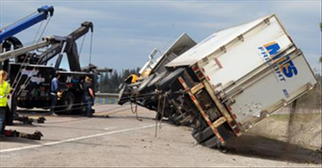 Truck carrying hydrochloric acid flips on Highway 35
