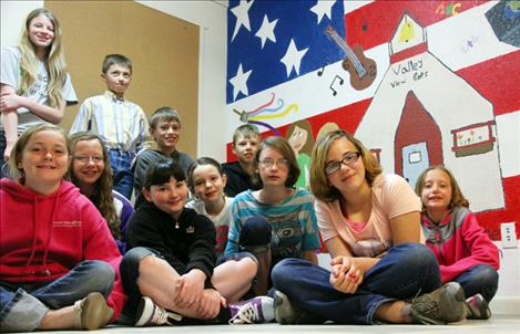 Valley View School's 3-6 grade students painted a mural on the lunchroom wall that portrays the hobbies, interests and values  of the student body. Artists pictured from back, left are: Kayleigh Burba, Clayton Jensen, TrapperMcAllister, Mason Sloan, (front, left) Shelby Learn, Alexys Orien, Shalom Walker, Ryleigh Bell, Tiana Crist, Emily Gerrity and Claire Crist. Not pictured are Ethan and Esaie Kinsey.