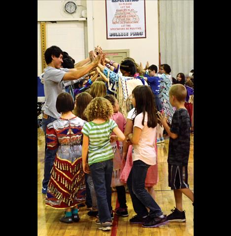 Students and guests wait for the powwow to begin in the Mission High School gym.