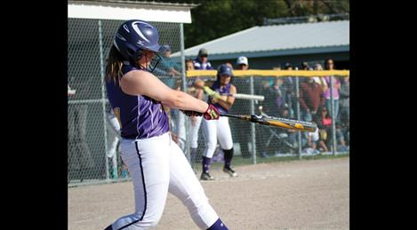 Lady Pirate catcher Sarah Rausch sports a homerun swing while launching the ball over the fence to put the Lady PIrates ahead of number one ranked Columbia Falls in Thursday's victory.