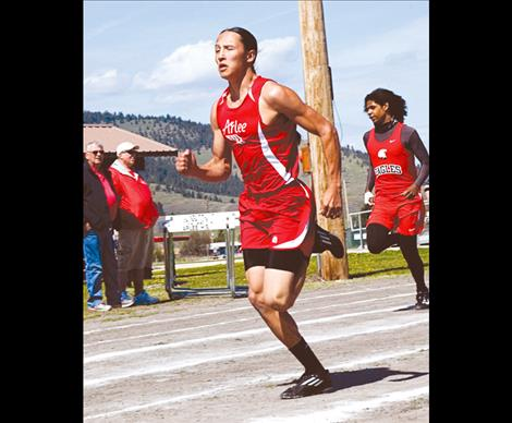 Arlee Warrior Isaac Desjarlais runs in a meet earlier this season. He placed fifth in the 100-meter dash last weekend at the Western C Divisional meet in Missoula.