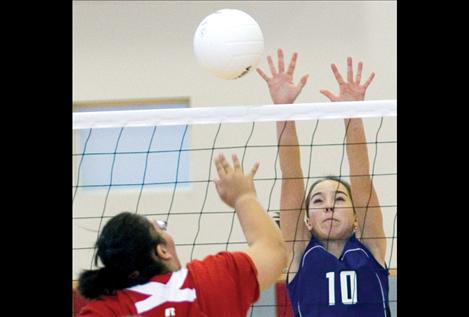 Mackenzie Foust attempts a block during district play.