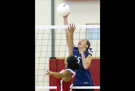 McKalistar Rosenbaum fires the ball over the net during Charlo's game against Two Eagle in the district tourney.