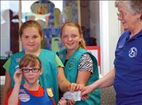 Girl Scouts donate money for shelter pups