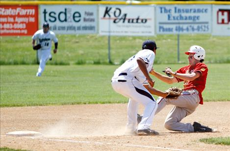 Mariners third baseman Jonah Burke tags out a Kalispell Lakers runner during the first round of Sunday's  doubleheader.