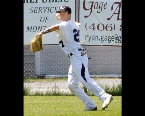 Kade Schutzmann rounds up a loose ball in the outfield.
