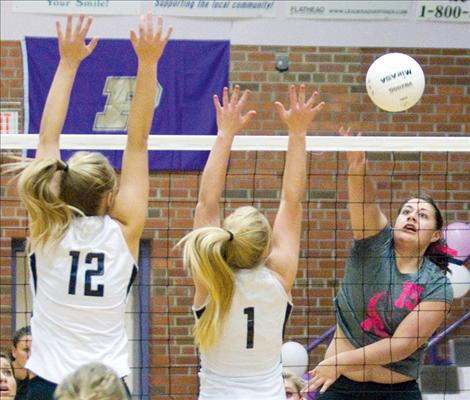 Chloie Huerta smacks the ball over the net during the Lady Pirates' game against Frenchtown two weeks ago.