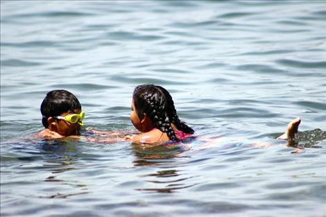 High temperatures send kids into the water to cool off.