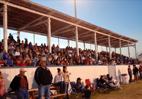 Spectators watch the United Indian Rodeo Association rodeo from the grandstands at the Polson fairgrounds. The grandstand seats, decks and walkways will be replaced with a grant received by Polson Fairgrounds Inc.