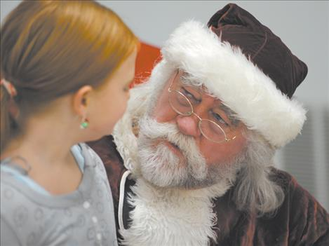 Santa Claus chats with Kiera Den Dekker at the Christmas  dinner Dec. 25.
