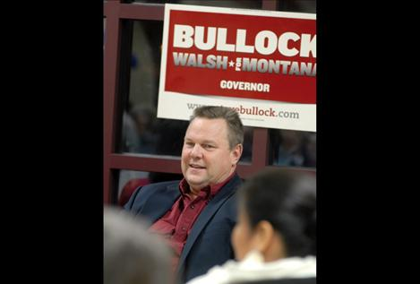 Waiting his turn to talk to the crowd at the Nov. 1 rally, U.S. Sen. Jon Tester takes a look at the audience.