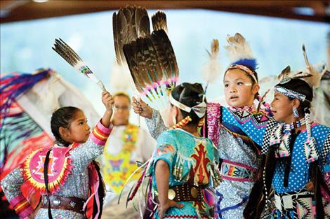 Four jingle dancers compete in the team dance.