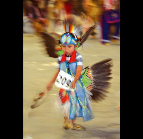 A young dancer twirls.