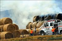 Hay fire put out by generous neighbors, department