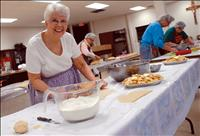 Humble pie: local church assembles pies for apple festival