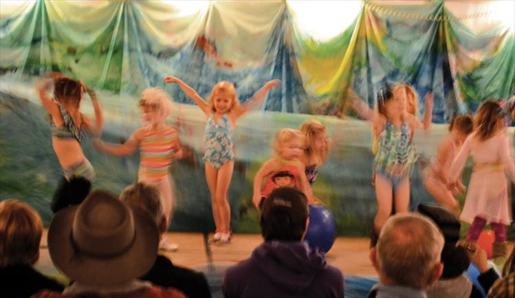"Tiny dancers become a colorful swarm of movement as they ""swim"" across the stage in the soup tent. The young performers take dance lessons from Julia Roberts at Mission Valley Dance."