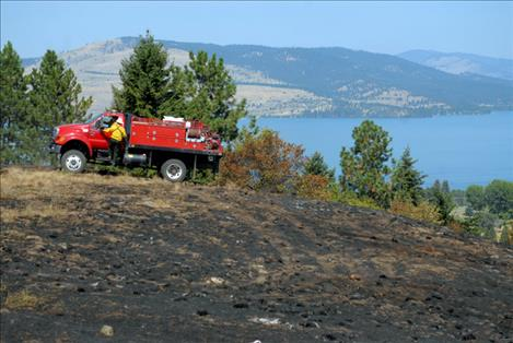 A crew from the Confederated Salish and Kootenai Division of Fire put 1,500 gallons of water on the burn the morning after.