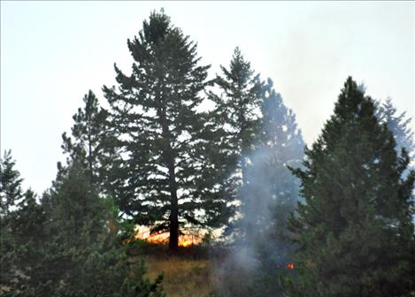 A lightning-caused fire flared up west of Polson hill Monday evening.
