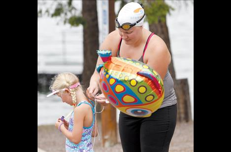 Von Jentzen helps a young Lake Monster with her balloon before the swim