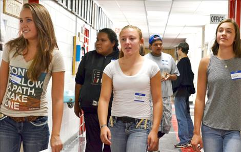 Freshmen students arrive at Arlee High School for orientation.