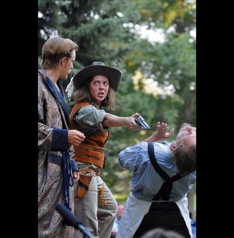 A man is held at gunpoint by Grumia during a performance of the Taming of the Shrew held in Palmer Park.