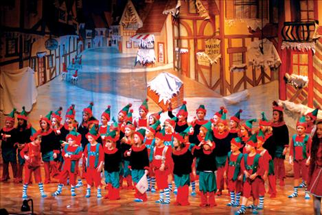 "Tiny elves fill the Ronan Performing Arts Center stage Friday evening for the premiere performance of ""Mrs. Claus is Missing."""