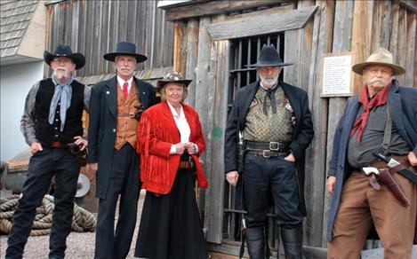 H.B. Whidden, Kent Ritz, Diane Kaechele, Charley Martin and Gary Riecke seem right at home in front of the jail at the Miracle of America Museum. They all belong to the Single Action Shooting Society.