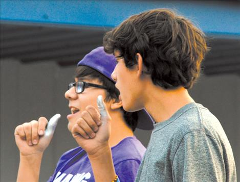 "Korbyn Hernandez and Wacey McClure sing into their thumb ""microphones"" during the lip sync contest."