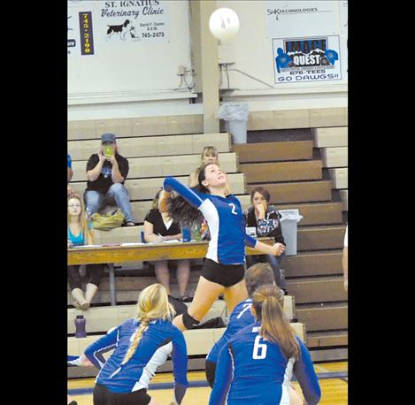 Mission senior Sydney Castor goes up for a swat Saturday at home.