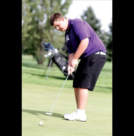 Carson McDaniel sinks a putt on the 18th hole at Polson Bay Golf Course during the Polson Invitational last week. McDaniel won the tournament, just three strokes over par.