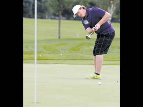 Senior Curtis Capdeville takes a putt during the Polson Invitational.