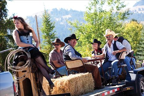 Outlaws and gunslingers ride through town during the parade.