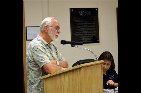 Paul Laisy, retired Missoula  Rural Fire Chief, speaks to the commissioners about the fire department split.
