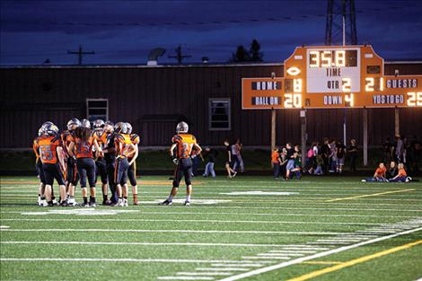 The Ronan Chiefs huddle during the second quarter of last Friday's game.