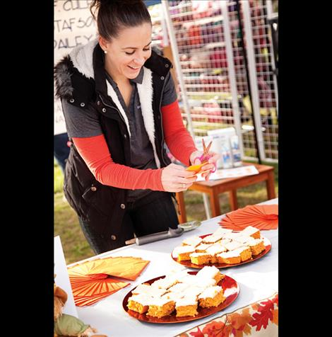 Amy Gustafson smiles as she serves up delicious baked goods.