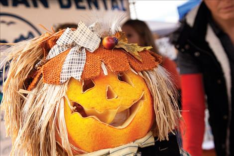 A smiling pumpkin welcomes  visitors to the Saturday festival.