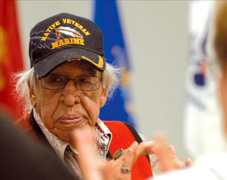 World War II Marine veteran and Salish elder Francis Stanger enjoys dinner and visiting with friends at a VFW dinner honoring veterans on Nov. 11.