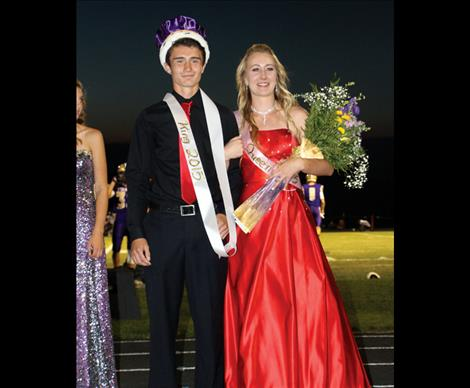 Homecoming King Jaben Wenzel and Queen Erin Sampson pose for photos after the crowning during half time at Friday's game.