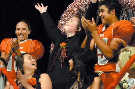 Homecoming King Darren Marks  celebrates  his victory