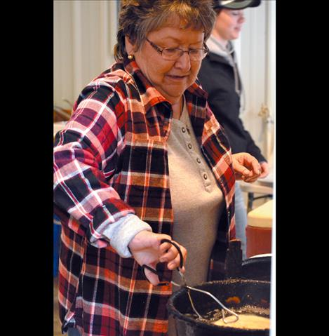 Nancy Vaughan makes frybread during the National Bison Range roundup.