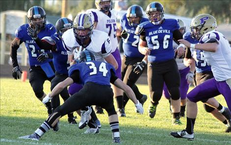 Polson Pirate Matthew Rensvold, above in an earlier home game, had four catches and a touchdown against Columbia Falls on Friday, and led defense with 10 tackles.