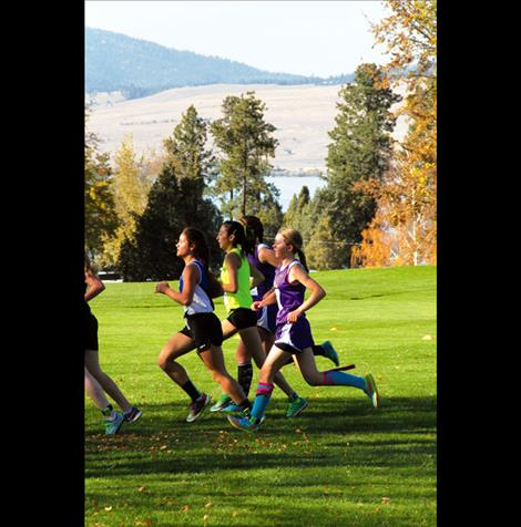 Lady Pirate sophomore Ryan Harrop races to a third place finish Saturday at the Western A Fall Classic conference championship meet in Polson.