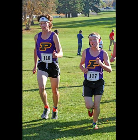 Matt Sitter, left, and Quin Stewart compete Saturday in Polson. Stewart crossed the finish at 17:20:24, the fastest time for the Polson boys' team.