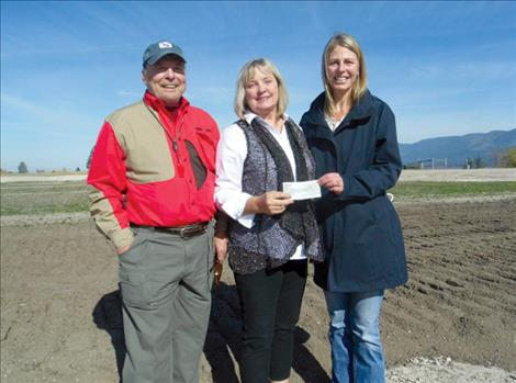 Mike and Janna Taylor are pictured with PYSA board member Sarah Beck Smith at the new Polson Youth Soccer Complex.