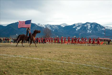 The Arlee Warriors begin each game with Louis Matt proudly parading the American flag.