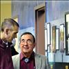 Salish Kootenai College President Robert DePoe III visits with past president Joe McDonald, right, on Monday at the unveiling of the Founder's Wall.