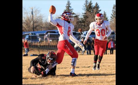 Tyler Tanner, left, and Colt Brazill battle through Saturday's state championship game in Chinook