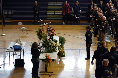 Polson Police Officer Michelle Scott pays final tribute to Officer William Cleveland.