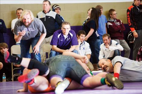 Coaches offer instruction and encouragement off the mats.